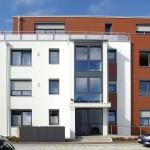 Die farbigen Fassadenplatten von FunderMax verleihen dem Gebäude ein optisches Highlight.  Bild: tdx/Mein Ziegelhaus
